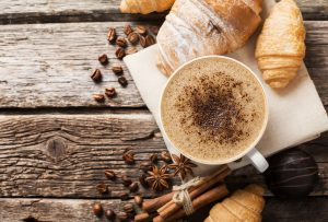 Image of coffee with croissants cinnamon.